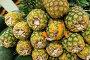 Lots of pineapples on supermarket stall, фото № 6398139, снято 8 августа 2014 г. (c) Elnur / Фотобанк Лори