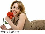 Купить «Красивая девушка с красной розой в руках», фото № 29119, снято 24 марта 2007 г. (c) Вадим Пономаренко / Фотобанк Лори