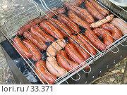 Купить «Жареные сосиски на решетке», фото № 33371, снято 23 сентября 2006 г. (c) Евгений Батраков / Фотобанк Лори