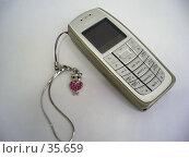 Купить «Мобильный телефон», фото № 35659, снято 15 апреля 2006 г. (c) Галина  Горбунова / Фотобанк Лори