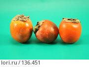 Купить «Три хурмы на зеленом фоне», фото № 136451, снято 1 декабря 2007 г. (c) Елена Блохина / Фотобанк Лори