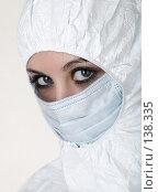Купить «Девушка в защитном костюме и маске», фото № 138335, снято 8 декабря 2006 г. (c) Serg Zastavkin / Фотобанк Лори