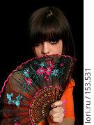 Купить «Девушка с веером в руке на черном фоне», фото № 153531, снято 4 мая 2007 г. (c) Александр Паррус / Фотобанк Лори