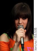 Купить «Девушка с микрофоном в руках на черном фоне», фото № 153535, снято 4 мая 2007 г. (c) Александр Паррус / Фотобанк Лори