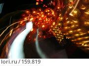 Купить «Праздничная ночная иллюминация на качели в парке аттракционов. Следы разноцветных ламп от движущегося аттракциона», фото № 159819, снято 11 июня 2005 г. (c) Harry / Фотобанк Лори