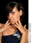 Купить «Девушка хвастается маникюром, на черном фоне», фото № 163503, снято 26 июля 2007 г. (c) Александр Паррус / Фотобанк Лори