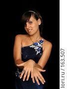 Купить «Девушка хвастается маникюром, на черном фоне», фото № 163507, снято 26 июля 2007 г. (c) Александр Паррус / Фотобанк Лори