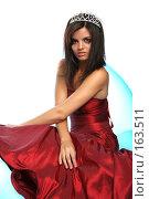Купить «Девушка в красном выпускном платье с диадемой, на надувном кресле», фото № 163511, снято 26 июля 2007 г. (c) Александр Паррус / Фотобанк Лори