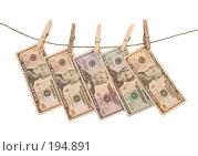 Купить «Доллары, висящие на бельевой веревке (отмытие грязных денег)», фото № 194891, снято 10 января 2008 г. (c) Harry / Фотобанк Лори