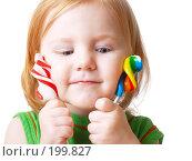 Купить «Девочка с конфетами на белом фоне», фото № 199827, снято 23 ноября 2007 г. (c) Майя Крученкова / Фотобанк Лори