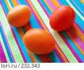 Купить «Пасхальные крашеные яйца на полосатой скатерти», фото № 232343, снято 25 января 2007 г. (c) only / Фотобанк Лори