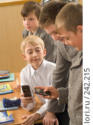 Купить «Сотовый телефон - самая популярная игрушка в школе», фото № 242215, снято 3 апреля 2008 г. (c) Федор Королевский / Фотобанк Лори