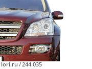 Купить «Фрагмент красного шикарного автомобиля», фото № 244035, снято 29 марта 2008 г. (c) Tatiana Lykova / Фотобанк Лори
