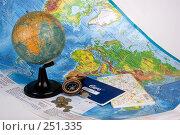 Купить «Натюрморт с картами, глобусом, компасом, деньгами и чековой книжкой в Евро», фото № 251335, снято 22 сентября 2018 г. (c) Harry / Фотобанк Лори