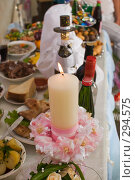 Купить «Свеча на свадебном столе - символ семейного очага», фото № 294575, снято 17 мая 2008 г. (c) Федор Королевский / Фотобанк Лори