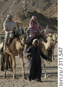 Купить «Катание на верблюдах», фото № 311547, снято 6 марта 2008 г. (c) Бондаренко Сергей / Фотобанк Лори