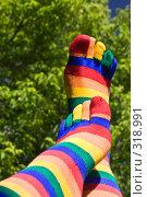 Купить «Носки на фоне зелени», фото № 318991, снято 8 июня 2008 г. (c) Суханова Елена (Елена Счастливая) / Фотобанк Лори