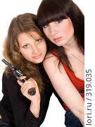 Купить «Две девушки и пистолет», фото № 319035, снято 2 мая 2008 г. (c) Сергей Сухоруков / Фотобанк Лори