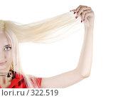 Купить «Сексуальная блондинка держит волосы», фото № 322519, снято 25 мая 2008 г. (c) Михаил Малышев / Фотобанк Лори