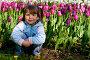Улыбающаяся девочка на фоне тюльпанов, фото № 334703, снято 23 мая 2007 г. (c) Ольга Сапегина / Фотобанк Лори