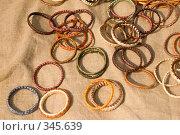 Купить «Плетеные браслеты», фото № 345639, снято 10 мая 2008 г. (c) Бутенко Андрей / Фотобанк Лори