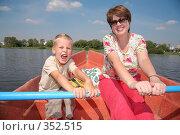 Купить «Женщина и мальчик в лодке с веслами», фото № 352515, снято 11 ноября 2019 г. (c) Losevsky Pavel / Фотобанк Лори