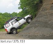 Купить «Вседорожный автомобиль въехал на горку», фото № 375151, снято 6 июля 2008 г. (c) Влад / Фотобанк Лори