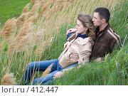 Купить «Парень и девушка сидят в камышах», фото № 412447, снято 20 апреля 2008 г. (c) Арестов Андрей Павлович / Фотобанк Лори