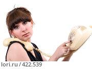 Купить «Девушка набирает номер на дисковом телефоне», фото № 422539, снято 1 июля 2008 г. (c) Сергей Сухоруков / Фотобанк Лори