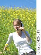 Купить «Девушка в наушниках», эксклюзивное фото № 426511, снято 11 августа 2008 г. (c) Natalia Nemtseva / Фотобанк Лори