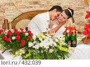 Купить «Свадьба. Молодожёны за праздничным столом.», фото № 432039, снято 23 августа 2008 г. (c) Федор Королевский / Фотобанк Лори