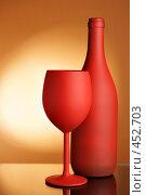 Купить «Красная бутылка и бокал на желтом фоне», фото № 452703, снято 19 ноября 2017 г. (c) Роман Сигаев / Фотобанк Лори