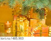 Купить «Коробки в красивой подарочной упаковке под еловой веткой на зеркале на желтом фоне», фото № 485903, снято 27 сентября 2008 г. (c) Мельников Дмитрий / Фотобанк Лори