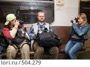 Купить «Фотографы едут в метро», фото № 504279, снято 12 апреля 2008 г. (c) Сергей Лаврентьев / Фотобанк Лори