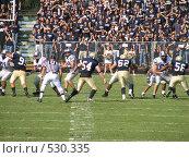 Купить «За секунду до броска. Американский футбол», фото № 530335, снято 14 октября 2006 г. (c) Yevgeniy Zateychuk / Фотобанк Лори