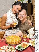 Купить «Молодая пара за новогодним столом», фото № 582351, снято 9 октября 2008 г. (c) Ольга Красавина / Фотобанк Лори