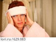 Купить «Женщина, страдающая головной болью», фото № 629083, снято 16 сентября 2008 г. (c) Vdovina Elena / Фотобанк Лори