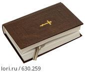 Купить «Евангелие с ключом на белом фоне», фото № 630259, снято 14 марта 2008 г. (c) Гребенников Виталий / Фотобанк Лори