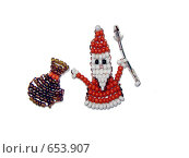 Купить «Дед Мороз с мешком подарков. Поделка из бисера», фото № 653907, снято 30 ноября 2008 г. (c) Наталья Лукина / Фотобанк Лори