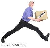 Купить «Курьер спешащий доставить посылку», фото № 658235, снято 21 декабря 2008 г. (c) pzAxe / Фотобанк Лори