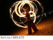 Купить «Девушка исполняет фаер шоу (огненный танец) ночью на пляже», фото № 689675, снято 4 сентября 2008 г. (c) Алексей Корсаков / Фотобанк Лори