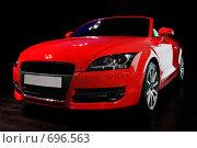 Купить «Красная спортивная машина на черном фоне», фото № 696563, снято 29 мая 2008 г. (c) Александр Косарев / Фотобанк Лори