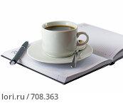 Бизнес-ежедневник со стоящей на нем чашкой кофе. Стоковое фото, фотограф Vitas / Фотобанк Лори