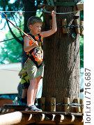 Купить «Мальчик на аттракционе в парке», фото № 716687, снято 20 июля 2008 г. (c) Игорь Бунцевич / Фотобанк Лори