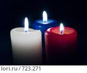 Купить «Три горящих свечи на черном фоне», фото № 723271, снято 25 февраля 2009 г. (c) Кирпинев Валерий / Фотобанк Лори