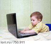 Купить «Мальчик за ноутбуком», фото № 750911, снято 14 марта 2009 г. (c) Александр Fanfo / Фотобанк Лори