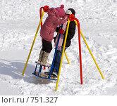 Купить «Две девочки на качелях зимой», фото № 751327, снято 15 марта 2009 г. (c) RedTC / Фотобанк Лори