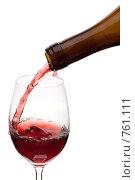 Купить «Красное вино, наливаемое из бутылки в бокал, на белом фоне», фото № 761111, снято 16 марта 2009 г. (c) Мельников Дмитрий / Фотобанк Лори