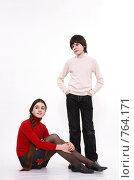 Купить «Парный портрет в рост: мальчик стоит, девочка сидит», фото № 764171, снято 3 марта 2009 г. (c) Юрий Викулин / Фотобанк Лори