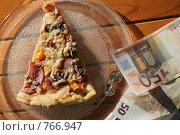 Купить «Кусок пиццы на блюде и евро», фото № 766947, снято 10 января 2009 г. (c) Gagara / Фотобанк Лори